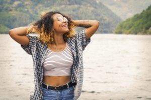 Smiling girl in outdoor lake setting