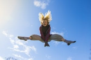 woman with energy jumping for joy outside