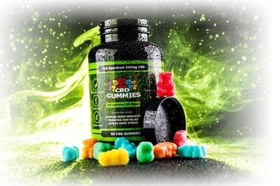 a bottle of hemp bombs cbd-infused gummies with gummy bears surrounding the bottle to help explain what cbd gummies are