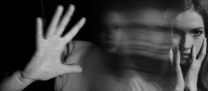 woman suffering from anxiety, her hand is up but her movement is foggy