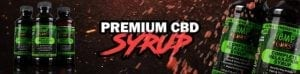 """Several bottles of Hemp Bombs Premium CBD Syrup with text that says, """"Premium CBD Syrup"""" on a red background"""