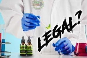 "a researcher works with bottles of hemp bombs cbd oil with text that says, ""are cbd oils legal?"""